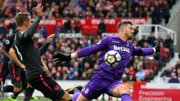 Stoke keeper Jack Butland saves from Arsenal's Aaron Ramsey