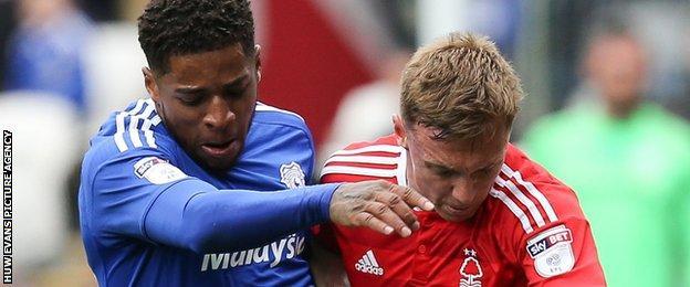Cardiff's Kadeem Harris and Forest's Ben Osborn tangle at the Cardiff City Stadium