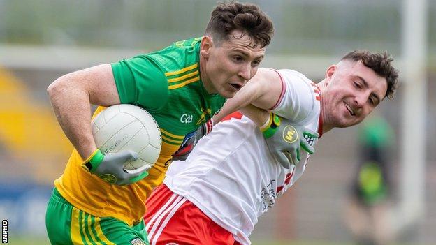 Jamie Brennan is challenged by Tyrone debutant Cormac Munroe