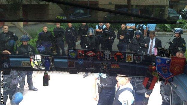 Police wait outside Russia coach