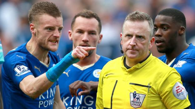 Leicester striker Jamie Vardy gestures at referee Jon Moss after his red card