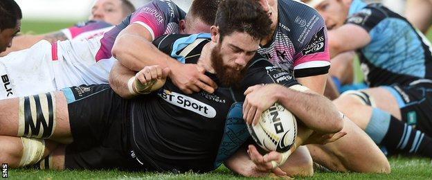 Greg Peterson manages to get the ball over the line to score a try for Glasgow Warriors