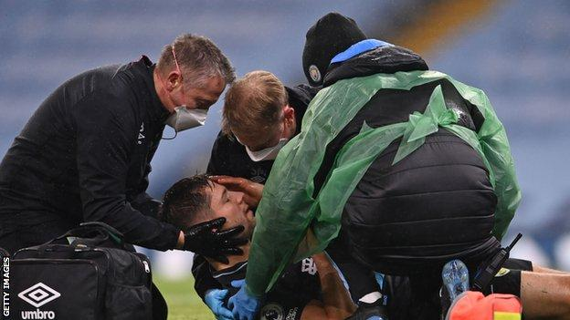 Burnley's James Tarkowski getting on-pitch treatment by doctors after suffering a head injury