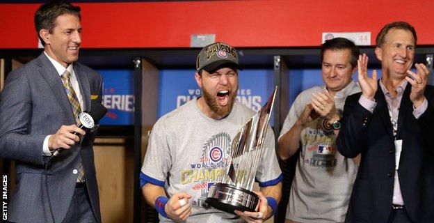 Ben Zobrist #18 of the Chicago Cubs celebrates with the 2016 World Series Most Valuable Player (MVP) Award