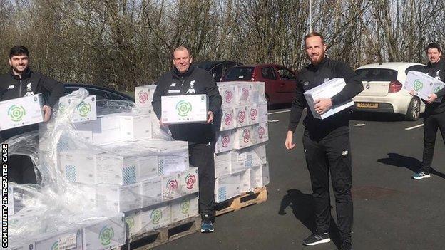 Liverpool FC Foundation staff deliver equipment