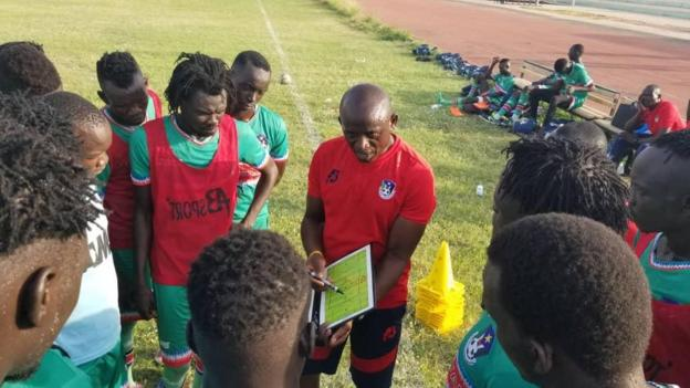 South Sudan coach Ashu Cyprian Besong explains tactics to his players
