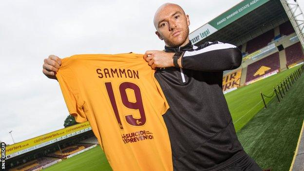 New loan signing Conor Sammon shows off his Motherwell shirt at Fir Park