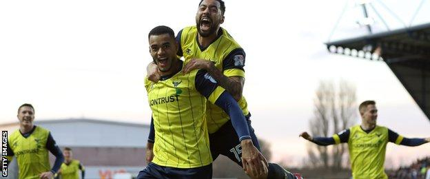 Curtis Nelson celebrates scoring Oxford's second goal