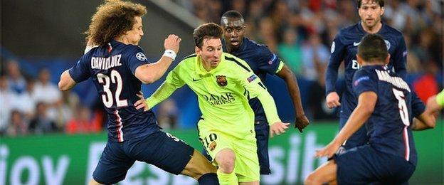 PSG defender David Luiz tackles Barcelona's Lionel Messi during the Champions League clash at the Parc des Princes last year