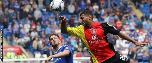 Craig Noone watches Birmingham's David Davis head the ball