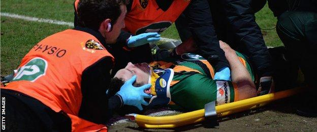 George North is treated after being hurt playing for Northampton in March 2015