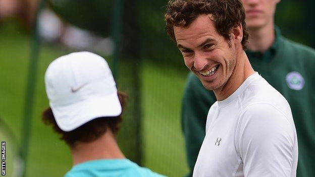Andy Murray shares a joke during practice at Wimbledon