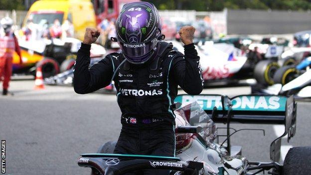 Lewis Hamilton celebrates winning the Spanish Grand Prix