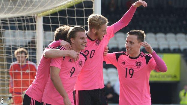 Scotland scorers Jason Cummings and Oliver McBurnie celebrate