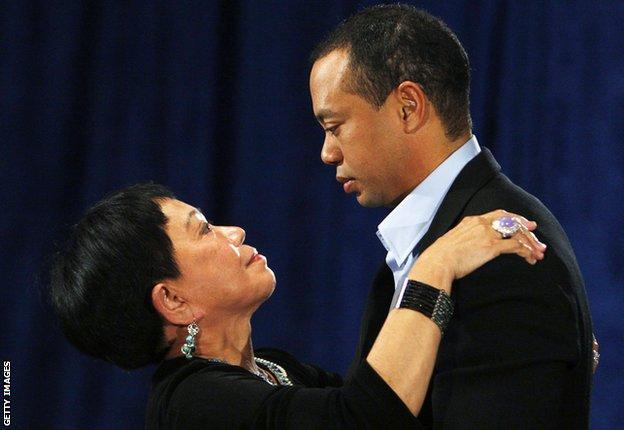 """Tiger Woods with his mother Kultida Woods after making a statement from the Sunset Room on the second floor of the TPC Sawgrass, home of the PGA Tour on February 19, 2010 in Ponte Vedra Beach, Florida. Woods publicly admitted to cheating on his wife Elin Nordegren but maintained that the issues remain """"a matter between a husband and a wife."""" (Photo by Joe Skipper-Pool/Getty Images)"""