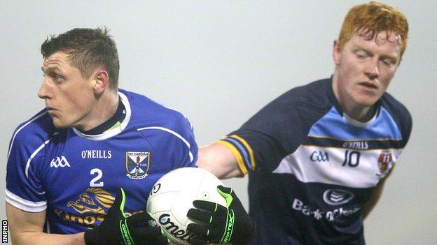 Fergal Reilly of Cavan in action against UUJ opponent Matthew Walsh