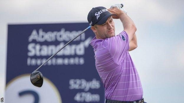 Russell Knox plays a tee shot during his third round