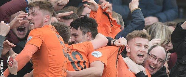 Carrick scored two late goals to grab victory at home to Ballinamallard United