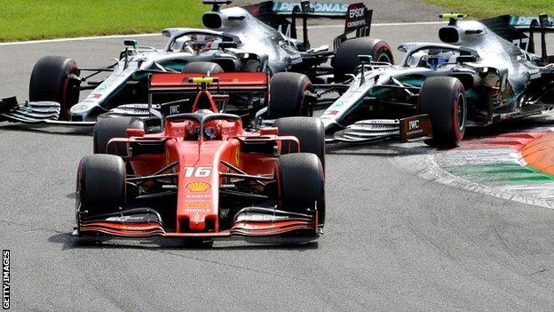 Charles Leclerc holds off the Mercedes of Valtteri Bottas and Lewis Hamilton
