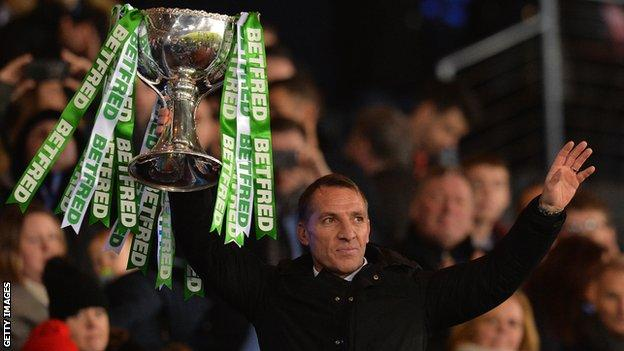 Brendan Rodgers lifts the Scottish League Cup in front of supporters after Celtic beat Aberdeen 1-0 in the final at Hampden Park in December