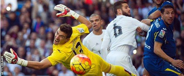 Getafe's goalkeeper Vicente Guaita dives for the ball during his side's 4-1 defeat at Real Madrid