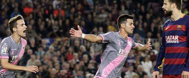 Javi Guerra celebrates scoring for Rayo Vallecano at Barcelona