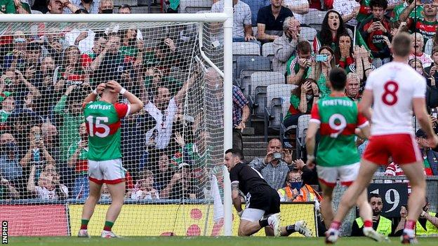 Ryan O'Donoghue holds his head in his hands after his missed penalty