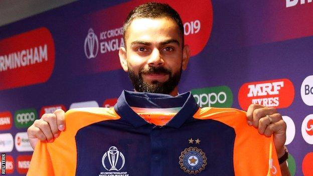 Virat Kohli shows off India's new 'away' kit