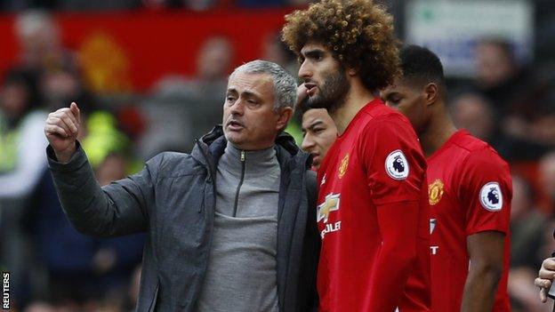 Manchester United's manager Jose Mourinho and midfielder Marouane Fellaini