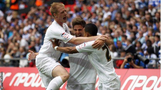 Alan Tate celebrates with Fabio Borini and Scott Sinclair during Swansea's play-off final win over Reading in 2011