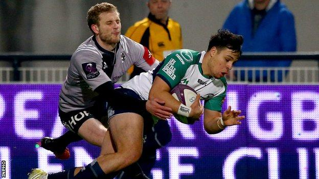 Rory Parata scores Connacht's early try despite the efforts of Brive's Guillaume Namy