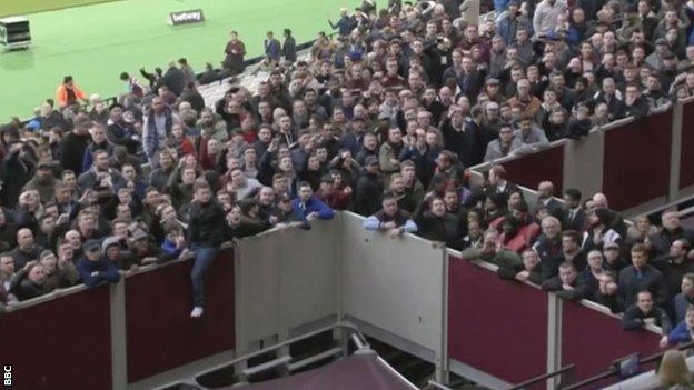 West Ham fans vent their anger towards the directors' box during the defeat by Burnley at London Stadium