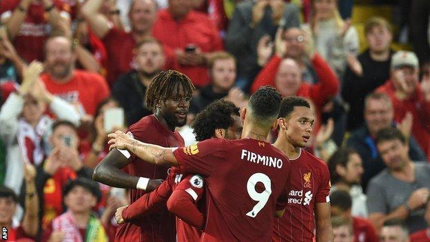 Divock Origi is congratulated by Liverpool players after scoring against Norwich