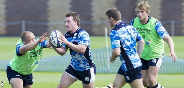 Stuart Hogg carries the ball during Scotland training