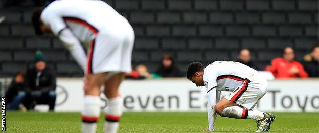 Josh Murphy falls to the ground after the final whistle