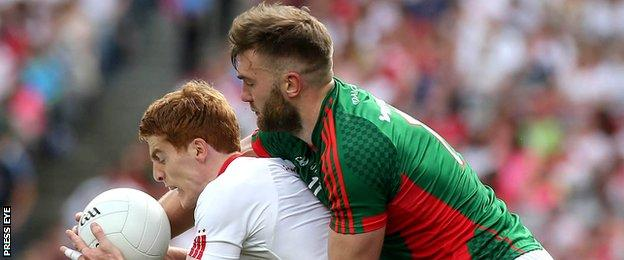 Tyrone's Peter Harte battles with Mayo's Aidan O'Shea in last year's All-Ireland quarter-final