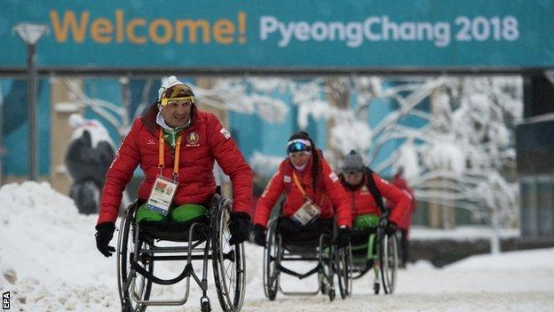 Athletes arriving at the Paralympic village