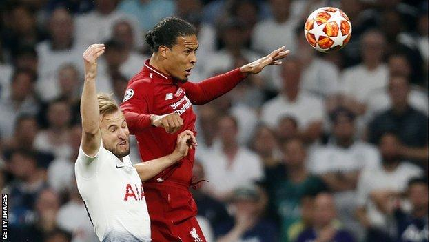 Tottenham striker Harry Kane and Liverpool defender Virgil van Dijk compete for a header during the Champions League final in Madrid