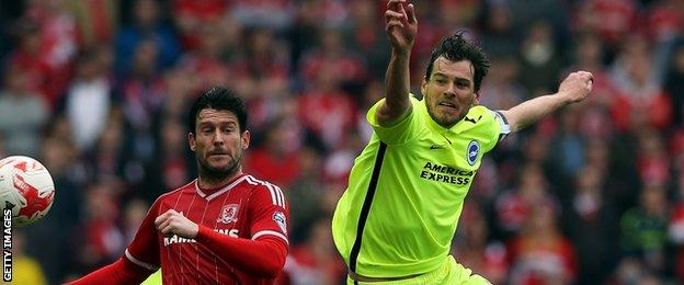 David Nugent of Middlesbrough is tackled by Gordon Greer for Brighton