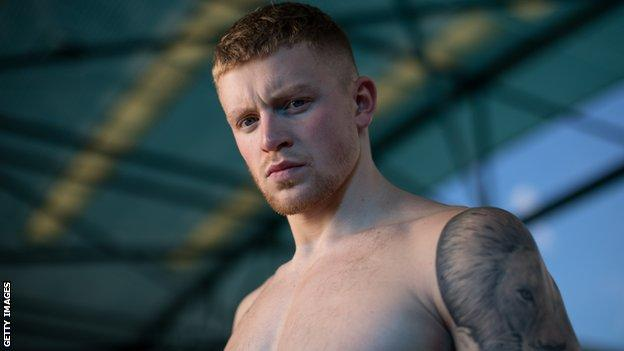 Adam Peaty poses at England's Commonwealth Games training camp in Brisbane