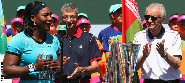 Moore (far right) applauds Williams after her win at Indian Wells at the weekend