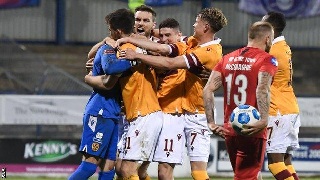 Trevor Carson is congratulated by his Motherwell team-mates