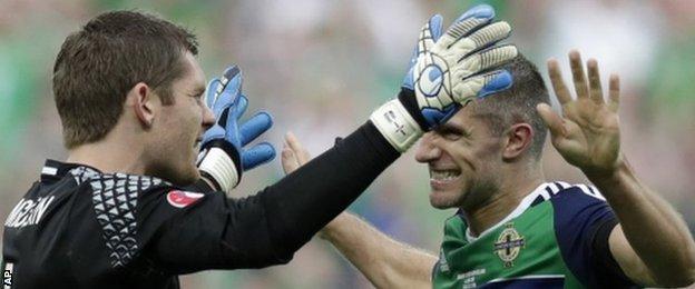 NI goalkeeper Michael McGovern and defender Aaron Hughes celebrate their win over Ukraine