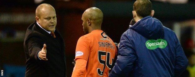 Dundee United manager Mixu Paatelainen and striker Florent Sinama-Pongolle