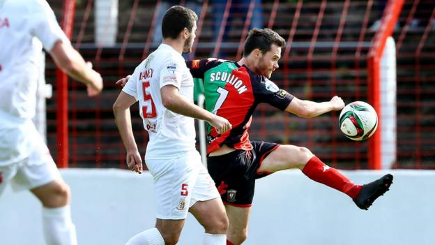 Portadown defender Chris Ramsey keeps tabs on Glentoran forward David Scullion at the Oval