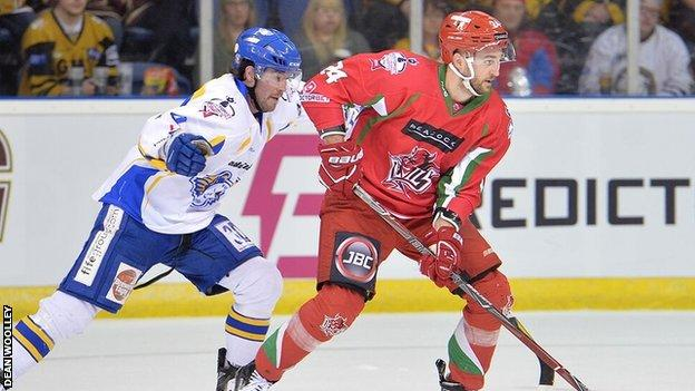Andrew Hotham takes the puck forward for the Devils