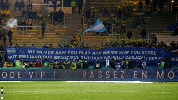 """A Cardiff banner reading: """"We never saw you play and never saw you score but Emiliano our beautiful bluebird we will love you forever more."""""""