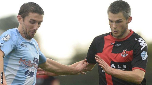 Ballymena's Gary Thompson in action against Crusaders defender Craig McClean