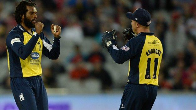 Recordo Gordon is congratulated by Bears wicketkeeper Tim Ambrose