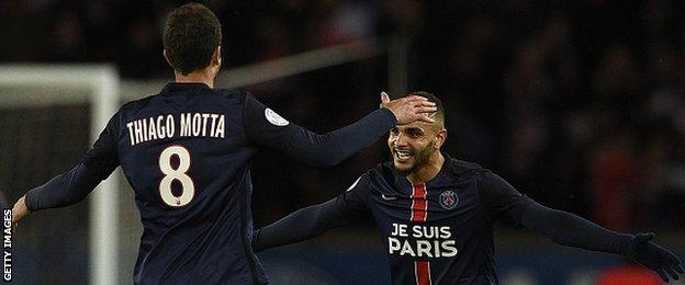 Paris St-Germain's Layvin Kurzawa (right) celebrates team-mate Thiago Motta during the win over Troyes